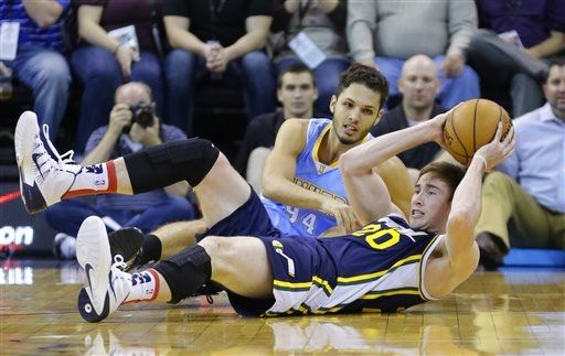Gordon Hayward literally lies on the floor as the Jazz figuratively lie on the floor of the NBA standings. (AP Photo/Rick Bowmer)