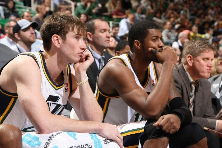 Like Gordon Hayward & Derrick Favors, we're all on the edge of our seats in '14 (Photo by Melissa Majchrzak/NBAE via Getty Images)
