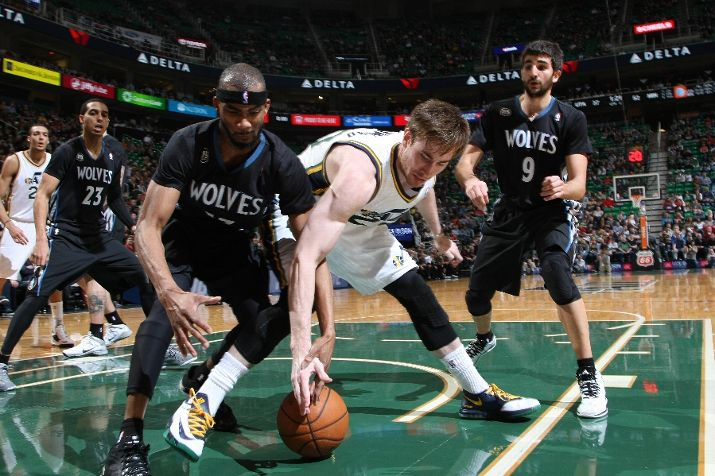 Wolves' Corey Brewer  and Utah's Gordon Hayward skirmish over  a fifty-fifty ball. Photo by Melissa Majchrzak/NBAE via Getty Images