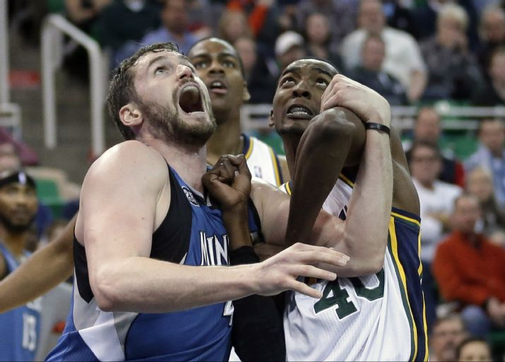 Kevin Love screams in delight about his triple-double. (AP Photo/Rick Bowmer)