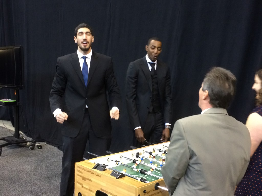 Enes Kanter and Jeremy Evans react to being scored on in foosball by Jazz TV man Steve Brown.