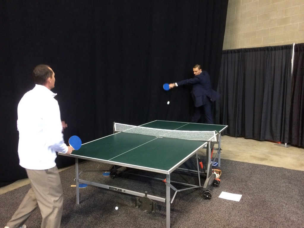 Andris Biedrins plays ping-pong with someone. Here, Biedrins looks very much like a blonde Dracula.