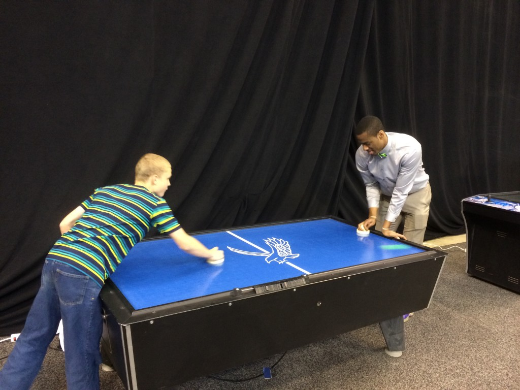 Alec Burks uses his tongue while focusing; in air hockey, basketball, and media interviews.