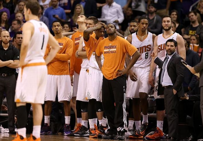 Mike Longabardi with Suns Players on Bench - Photo by Christian Petersen - Getty Images