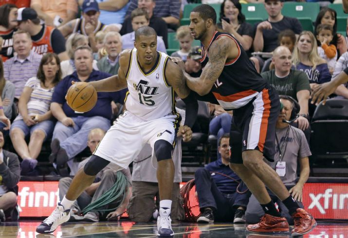 "Derrick Favors says he ""loves"" LaMacrus Aldridge's game. (AP Photo/Rick Bowmer)"