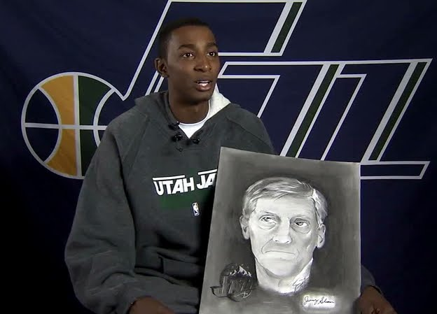 Jeremy holds his portrait of Jerry Sloan, done while Sloan was still coaching Evans and the Jazz.