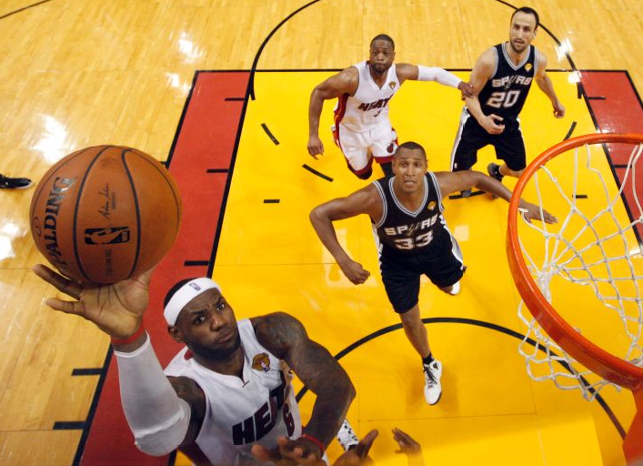 LeBron's Heat? Or the Spurs? Dowsett and Clayton go toe-to-toe. (AP Photo/Wilfredo Lee)