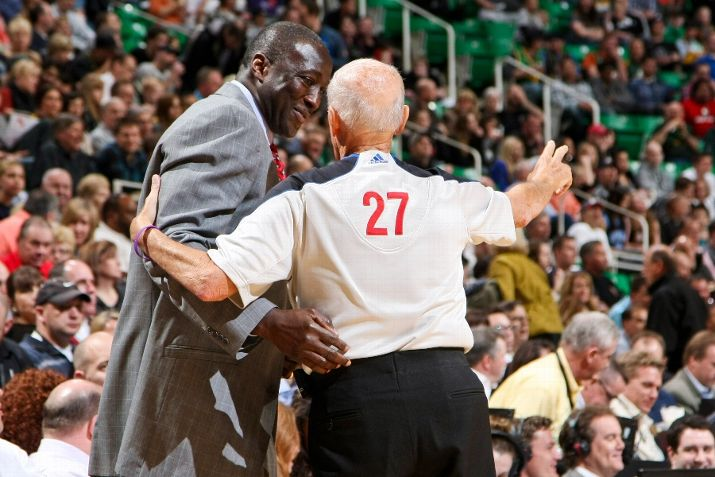 Jazz coach Ty Corbin talks to NBA referee Dick Bavetta during a game. (Photo by Melissa Majchrzak/NBAE via Getty Images)