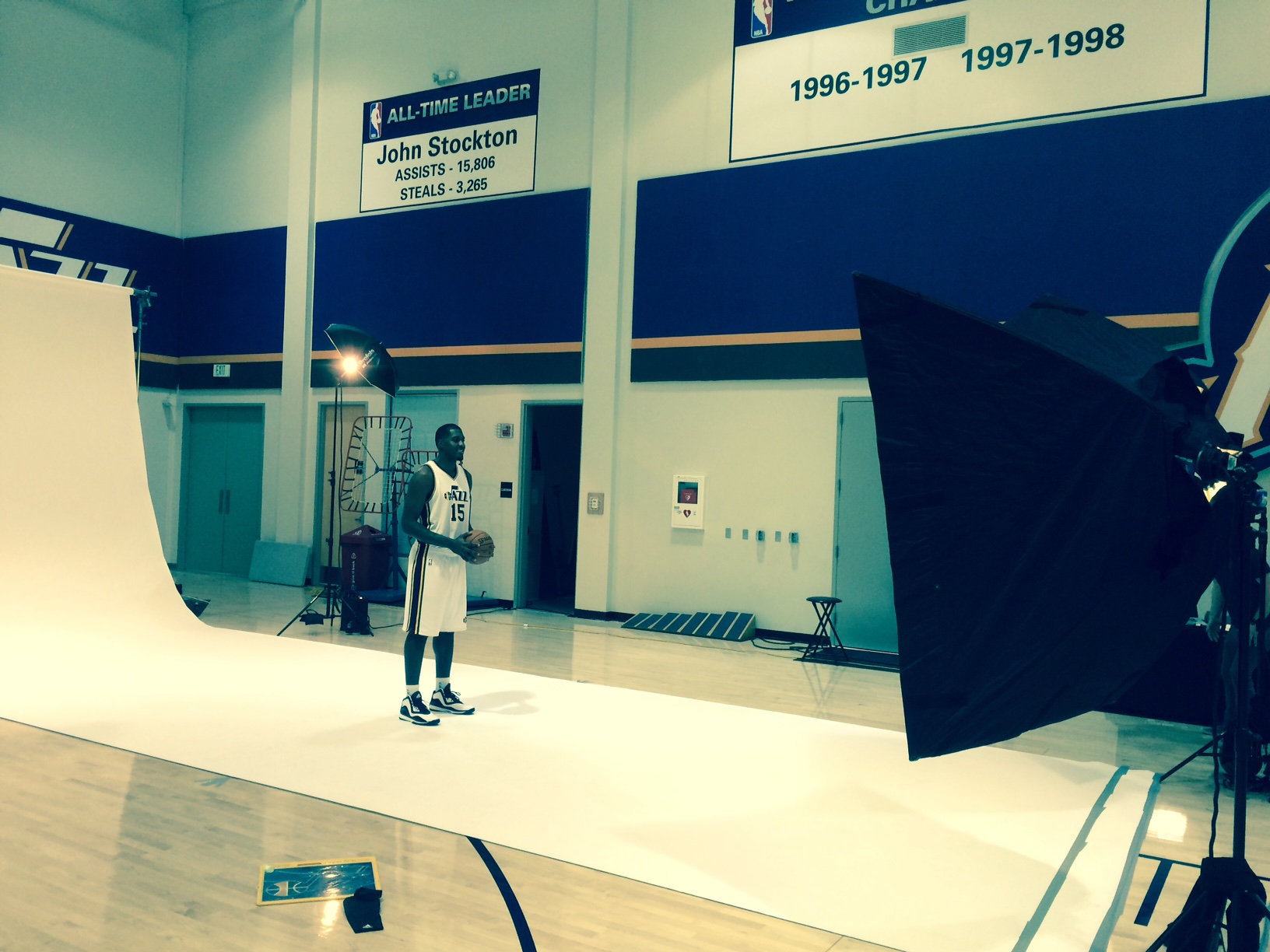 Derrick Favors takes a photo at media day.