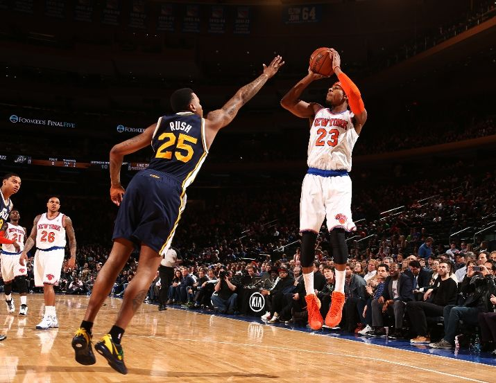 New Jazz PG Toure' Murry shoots over old Jazz SG Brandon Rush. (Photo by Nathaniel S. Butler/NBAE via Getty Images)