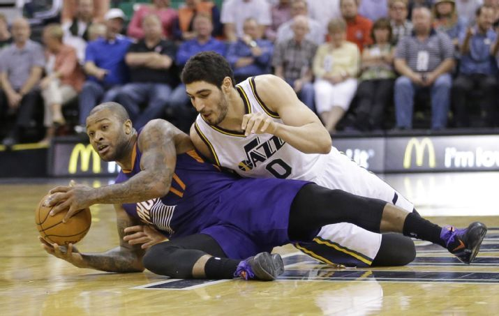 Another fine entry into the collection of great Enes Kanter photos. (AP Photo/Rick Bowmer)