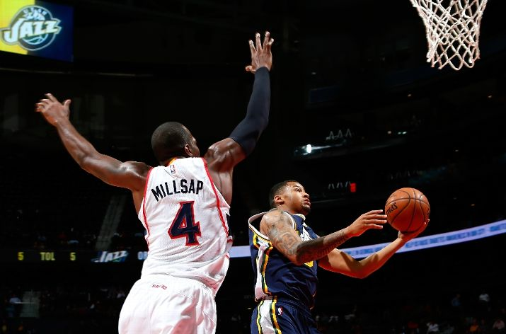 Paul Millsap and Trey Burke are two big topics of conversation on this week's Salt City Hoops Show. (Photo by Kevin C. Cox/Getty Images)