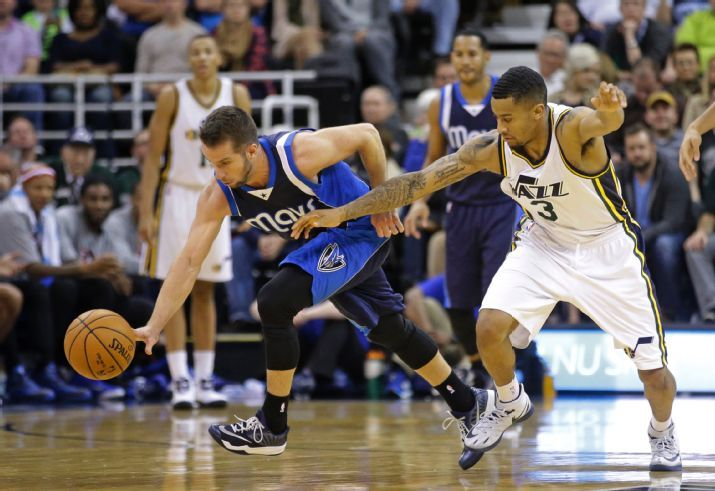 The Jazz had a lot of turnovers tonight like this one, an easy steal by JJ Barea in the 4th quarter. (AP Photo/Rick Bowmer)
