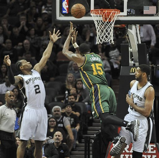 San Antonio's defense had Utah off balance all night, and not just on his Derrick Favors shot. (Darren Abate — AP Photo)