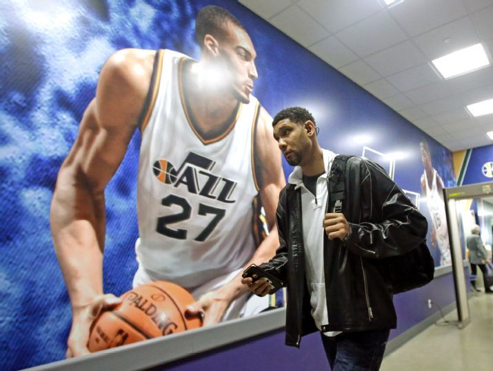 In a harbinger of what's to come, Rudy Gobert towers over Tim Duncan. (AP Photo/Rick Bowmer)
