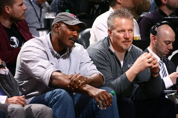 Jazz CEO Greg Miller sits with Karl Malone at a Jazz game last season. (Getty Images)