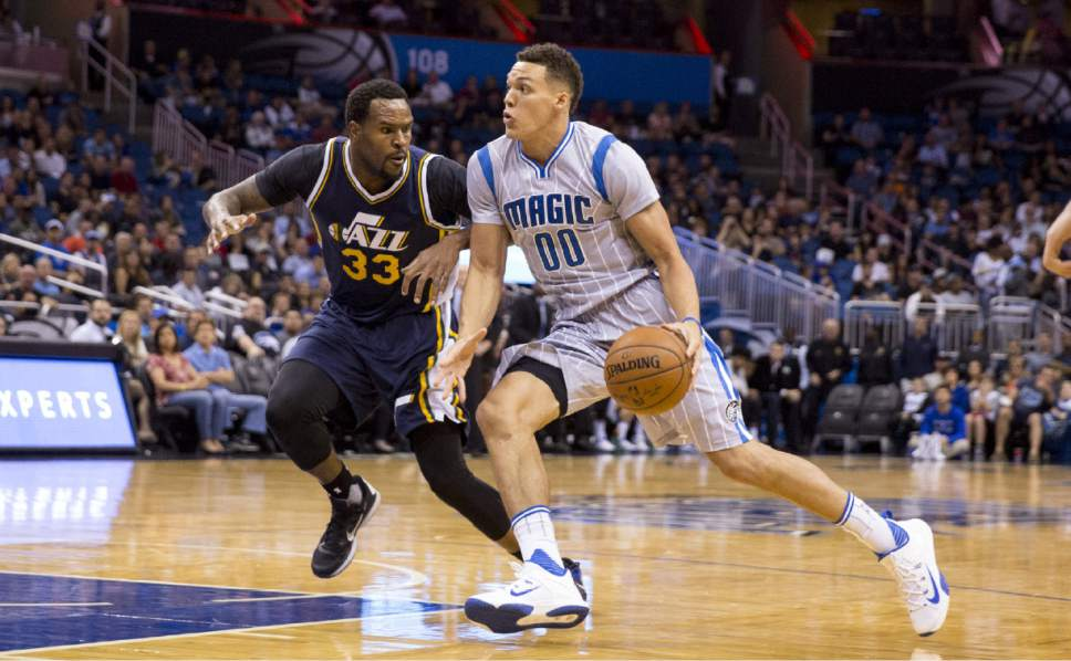 As was the case here with Trevor Booker and Aaron Gordon, the Jazz were simply a step behind the Magic all night. (AP Photo/Willie J. Allen Jr)