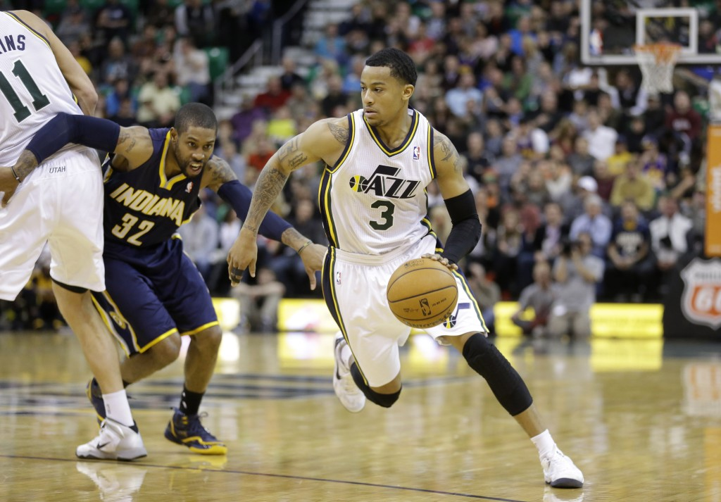 Trey Burke's improvement has been a nice story for the Jazz this season. (AP Photo/Rick Bowmer)